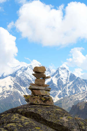 pyramid of stones and mountains with blue cloudy sky in the background  photo