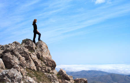 girl standing at the edge of rock Stock Photo - 5421178