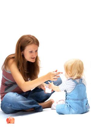 mother feeding child on a white background  photo