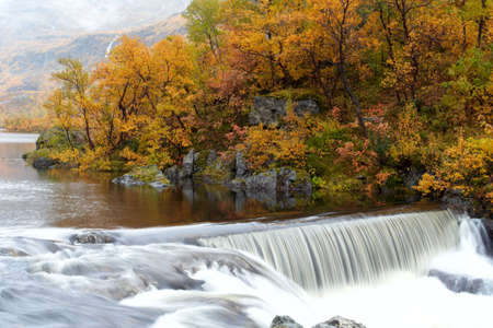 waterfall in the autumn woods, norway  Stock Photo