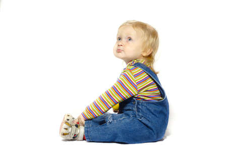 sitting child with the apple on a white background  photo