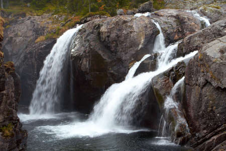 two large waterfall in the autumn woods, norway Stock Photo - 6048504