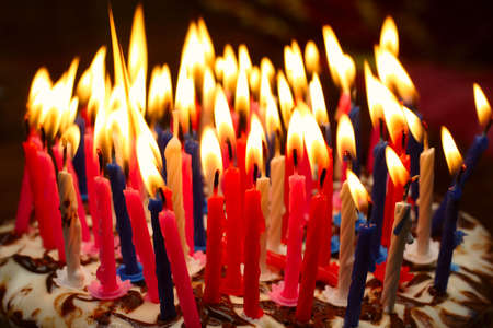 birthday cake with the lot of burning candles