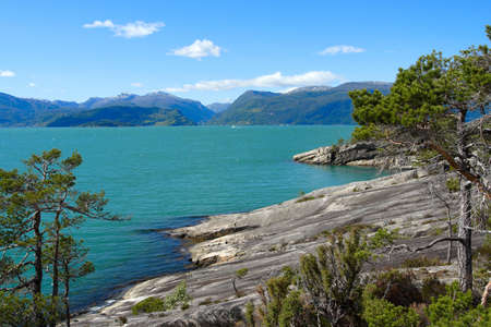 rocky coast and mountains in the distance, norway  Stock Photo