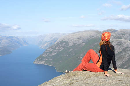 girl hiker sitting on a brink rock and looking at the mountains Stock Photo - 7498116