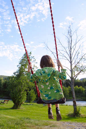 little girl rolling on a swing at the park Stock Photo - 7498184