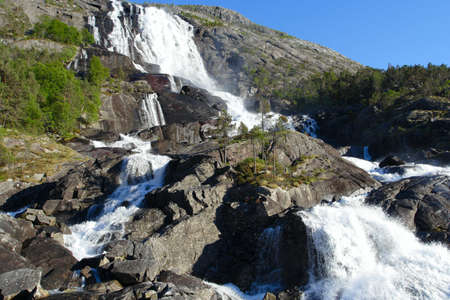 large waterfall in the summer woods, norway Stock Photo - 7711570