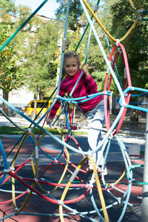 smiling little girl playing at the playground