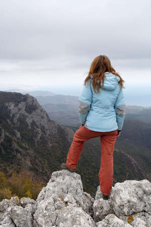 girl standing at the edge of rock Stock Photo - 8111301