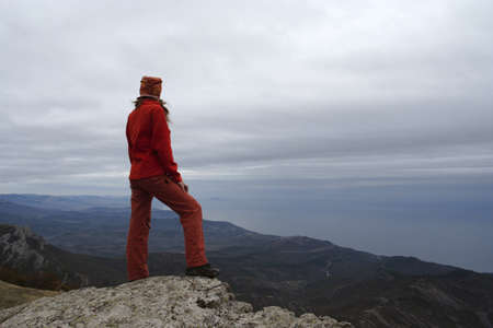 girl standing at the edge of rock Stock Photo - 8111295