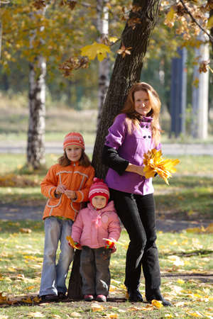 mother with daughters walking at the park Stock Photo - 8245019