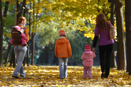 mother with daughters walking at the park