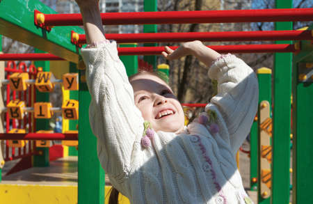 smiling little girl playing at the playground Stock Photo - 8462400