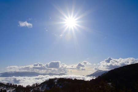 winter sun shining over the snowed mountains