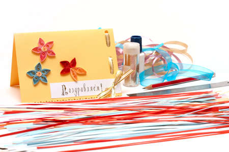 hand made scrapbooking post card and tools on a white background close-up  photo