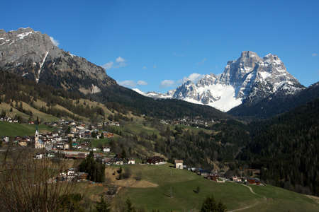 panorama of italian Dolomites with mountain village at the bottom