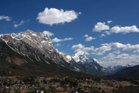 panorama of italian Dolomites with mountain village at the bottom Stock Photo - 9862551