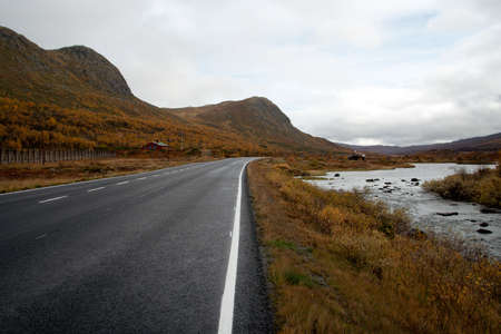 empty autumn road at the norwegian mountains. photo