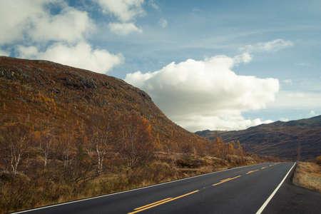 empty autumn road at the norwegian mountains. photo