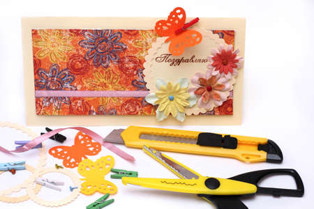 hand made scrapbooking post card and tools lying on a table. Stock Photo