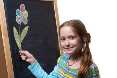 little smiling girl holding a flower that drawn with chalk on a blackboard  photo