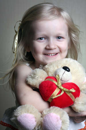 girl with toy bear  photo
