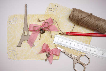 hand made scrapbooking post card and tools lying on a table  Banco de Imagens