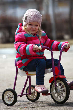little girl drive on a bike at the outdoors Stock Photo - 13339176