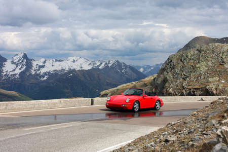 red car at the mountains,  italy