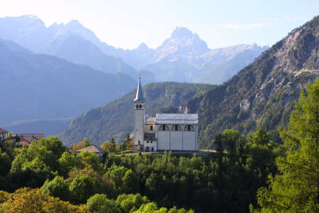mountain village with the church at the Alps 