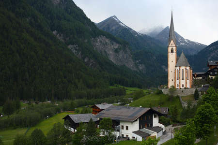 mountain village with the church at the Alps Stock Photo - 14216815
