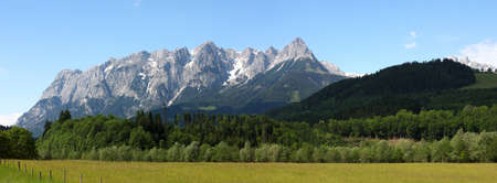 panorama of a green valley with snowed mountains in the distance Stock Photo - 14484484