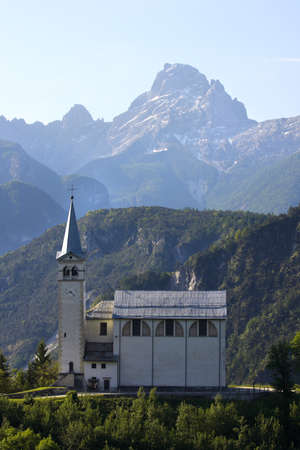 mountain village with the church at the Alps Stock Photo - 15184031