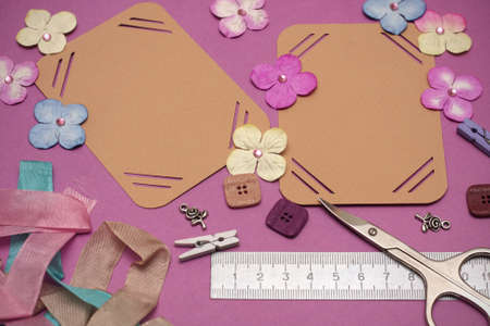 hand made scrapbooking album and tools lying on a table  photo