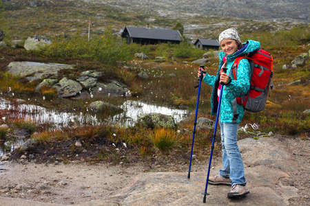 girl hiker at the norwegian mountains  photo