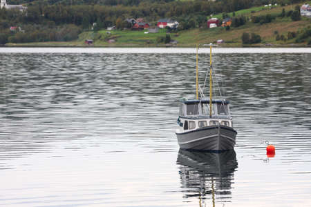 poling: moored yacht at the bay of Lofoten archipelago, Norway