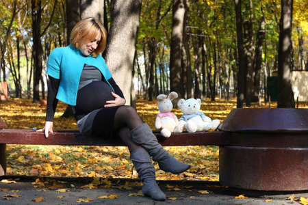 pregnant girl at the outdoors  photo
