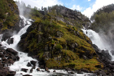 waterfall lotefossen in the autumn woods, norway Stock Photo - 16401962