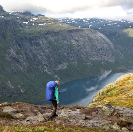 girl hiker going by path at the norwegian mountains  photo