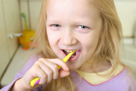 little blonde girl with toothbrush  photo