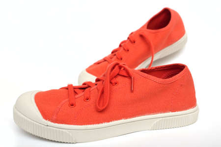orange sneakers on a white  photo