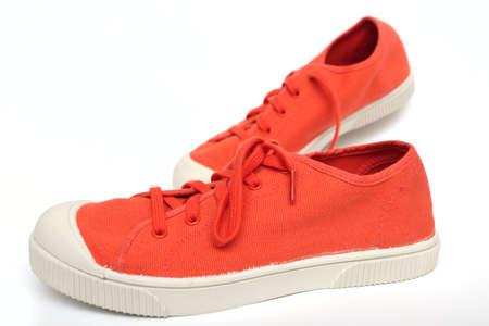 orange sneakers on a white  photo