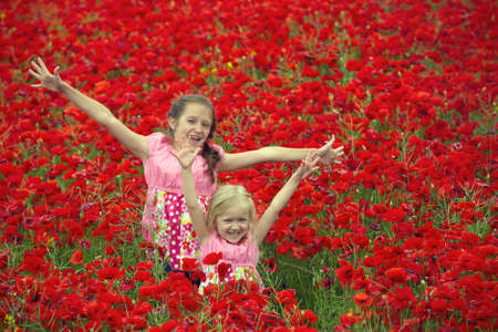 young girls at the poppies field  photo
