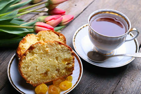 cake and cup of coffee on a vintage wooden table  photo