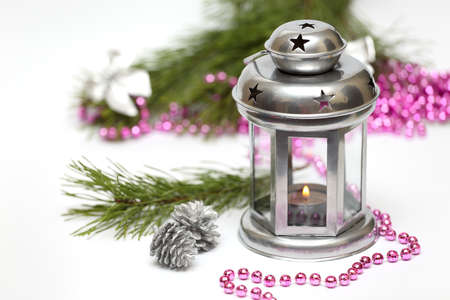 Christmas lantern with Christmas toys and fir tree branches  photo
