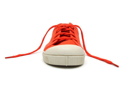 orange sneakers on a white background  photo