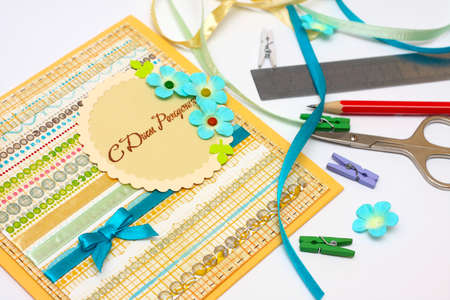 scrapbook background. Card and tools with decoration   photo