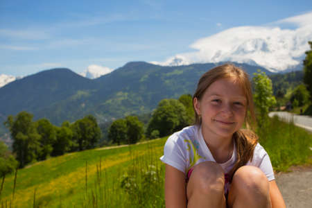 girl outdoors and mountains background  photo