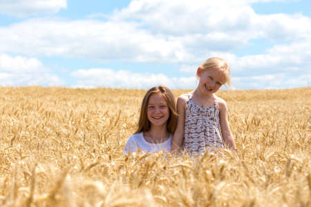 joys: young girls joys on the wheat field   Stock Photo