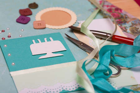 scrapbook background. Card and tools with decoration   Stock Photo